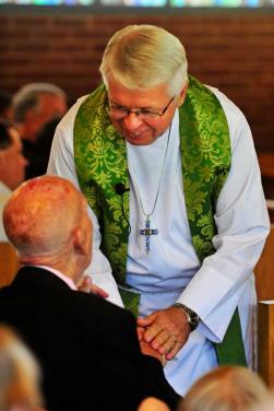 pastor shaking hands